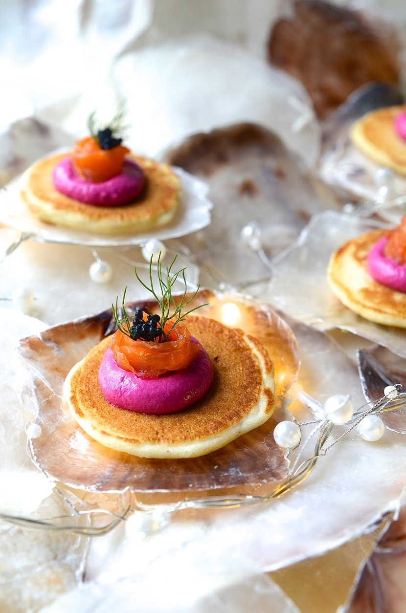 Buckwheat blinis with beetroot pâté and salmon ribbons