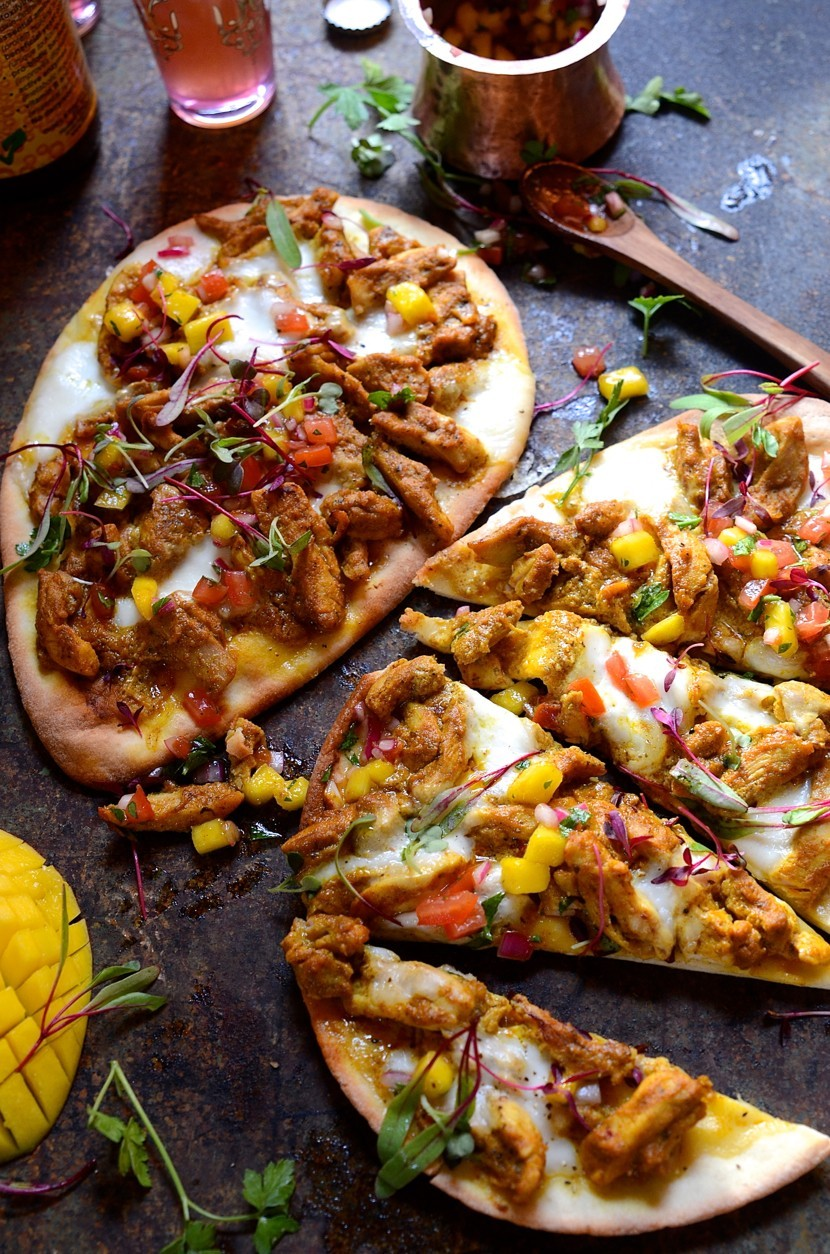 Chicken korma naan bread pizza with mango and tomato salsa