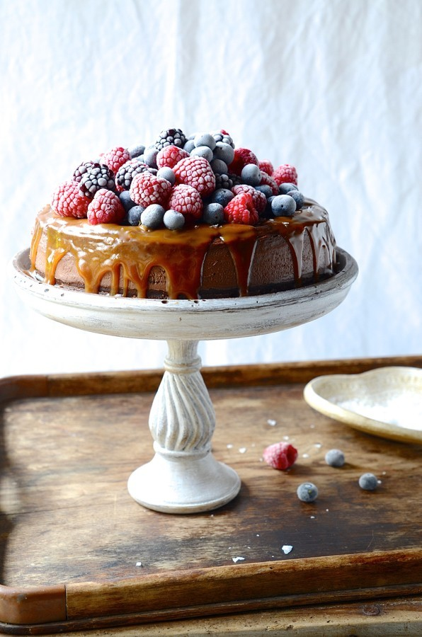 Chocolate cheesecake with salted caramel and frosted berries