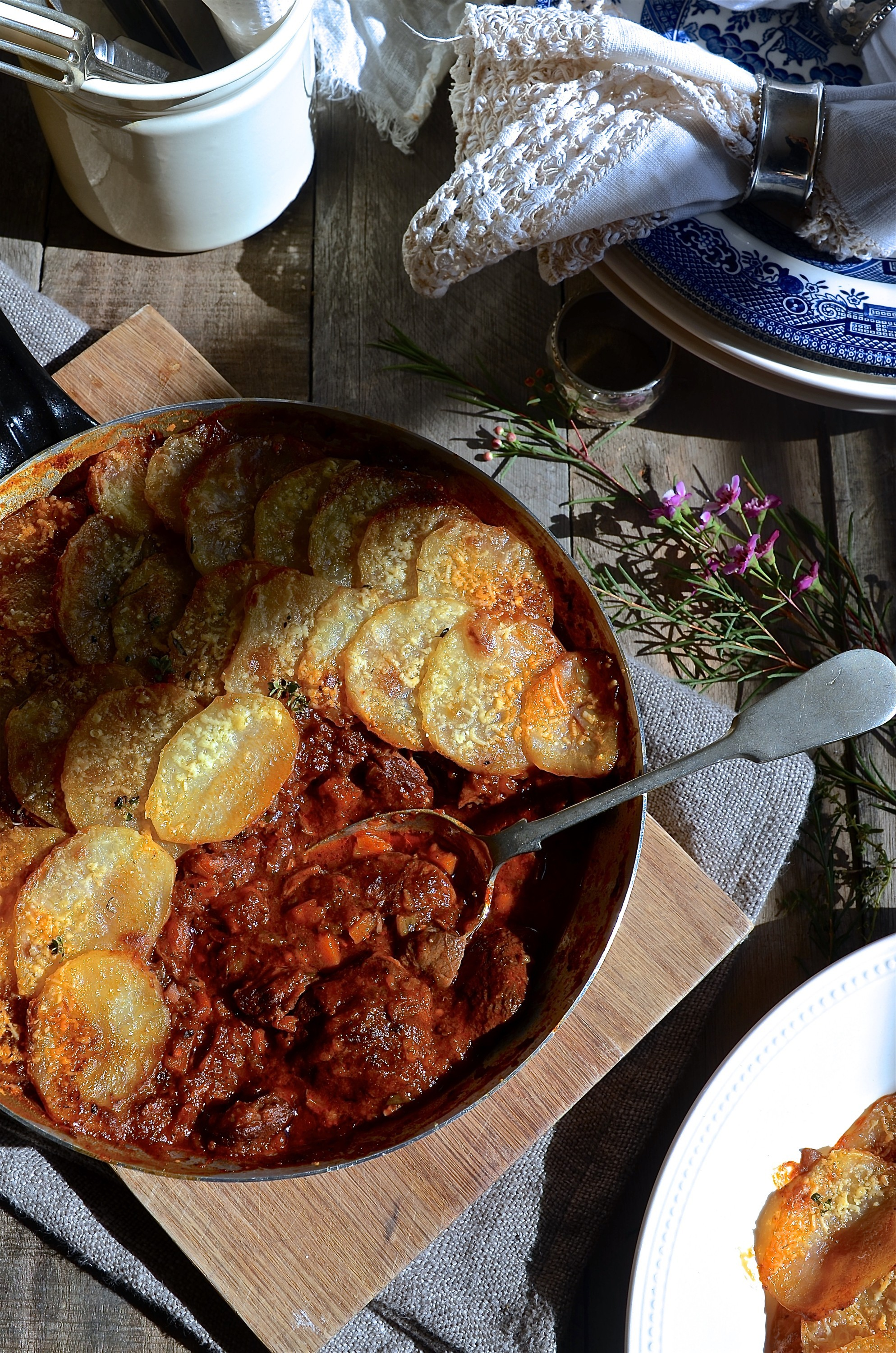 Red wine beef stew with potato gratin